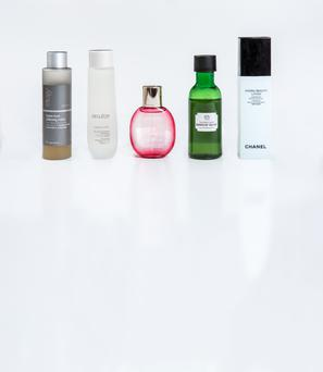 Pictured, from left, Trilogy Hydra-Tone Softening Lotion; Decleor Hydra Floral Anti-Pollution Hydrating Active Lotion; Clarins Fix' Make-Up; Body Shop Drops of Youth Essence Lotion; Chanel Hydra Beauty Lotion Very Moist. Photo: kip carroll