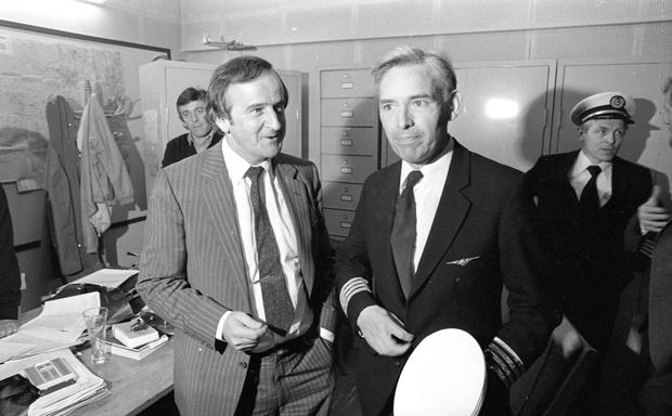 Safe landing: Then Transport Minister Albert Reynolds pictured with Captain Edward Foyle at Le Touquet Airport in France the day after the hijacking of Aer Lingus flight 164 -Part of the Independent Newspapers Ireland/NLI Collection.