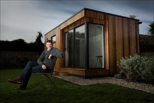 John Sherry, managing director of Garden Rooms, in front of one of their units. Photo: Dave Conachy