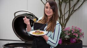 Vicki Notaro tries her barbecued Singapore noodles at the Weber Grill Academy at The Orchard in Celbridge in Kildare. Photo: Mark Condren