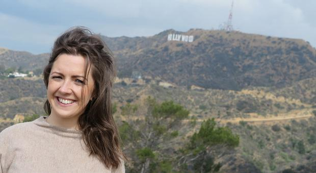 Claire McCormack in LA with the iconic Hollywood sign in the background.