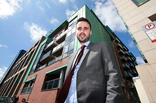 Moving up: Dublin Chamber of Commerce's Graeme McQueen on Dublin's Barrow Street, in the Grand Canal development area, where workers from Google and Facebook pay up to €3,000 per month to live in towers like the 16-floor Alto Vetro building. Photo: Frank McGrath