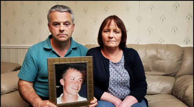 Tragedy: Jimmy and Essie Nolan at their home in Blessington with a photo of James, who died in Poland in June 2012. Photo: Steve Humphreys