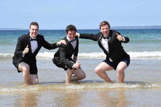 League of their own: Rose of Tralee escorts Mark Duffey, Damian McLarnon and Cieran Crowley take to the beach in Co Kerry for a weekend of fun Photo: Dominick Walsh.