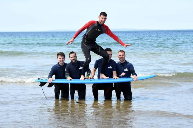 Rose of Tralee escorts take to the beach at Ballybunion in Co Kerry for a weekend of fun around Kerry.