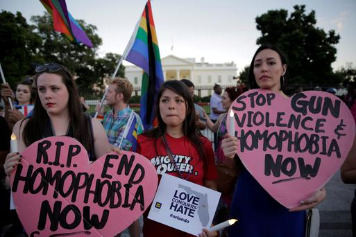 Call for change: A vigil in front of the White House on Sunday in support for the victims and their families who were killed in the Orlando nightclub massacre.