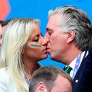 Loved up: Emma English and John Delaney, FAI chief executive, share a moment in the stands at the Ireland v Belgium match in Bordeaux.