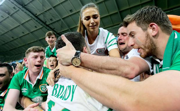 Emotion: Robbie Brady celebrates with his girlfriend Kerrie Harris and supporters after the game.