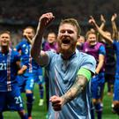 Over the moon: Iceland's midfielder Aron Gunnarsson and team mates celebrate after their 2-1 defeat over England in the last 16 of the Euros on Monday. Photo: AFP/Getty Images