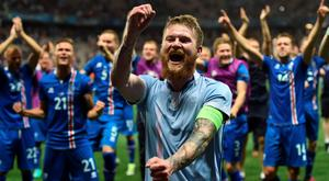 Over the moon: Iceland's midfielder Aron Gunnarsson and team mates celebrate after their 2-1 defeat over England in the last 16 of the Euros. Photo: AFP/Getty Images