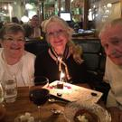 Family time: Claudia enjoying quality time with her parents Anne and Claude Carroll.