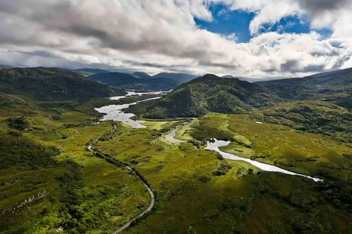 The Long Range River, Killarney, flows between the Eagle's Nest mountain and the Ring of Kerry road.