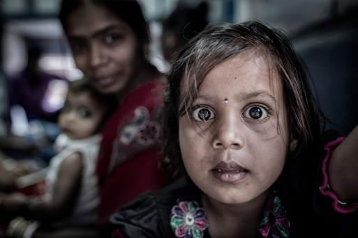 A young girl on a train in the city of Varanasi. Photo: Arthur Carron
