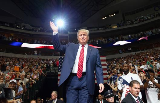 Republican presidential candidate Donald Trump arrives at a campaign rally at the American Airlines Center on September 14, 2015 in Dallas, Texas.
