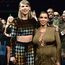 Taylor Swift wraps an arm around Kim Kardashian while watching Kim's husband Kanye West on stage at the 2015 MTV VMAs