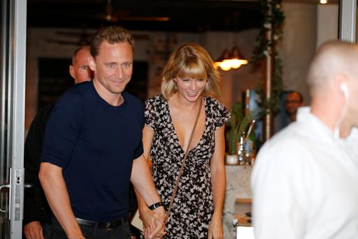 Actor Tom Hiddleston and singer Taylor Swift leave restaurant 'Gemelli Italian' in Broadbeach on the Gold Coast, Queensland