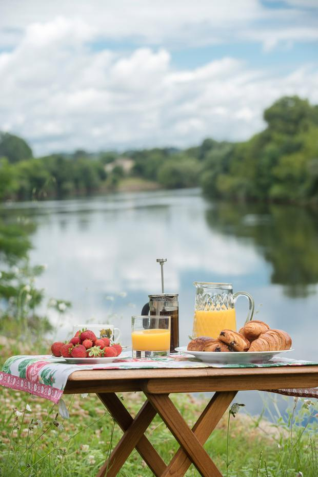 The weather is so good in this part of France that Nell and her guests usually have breakfast by the river's edge