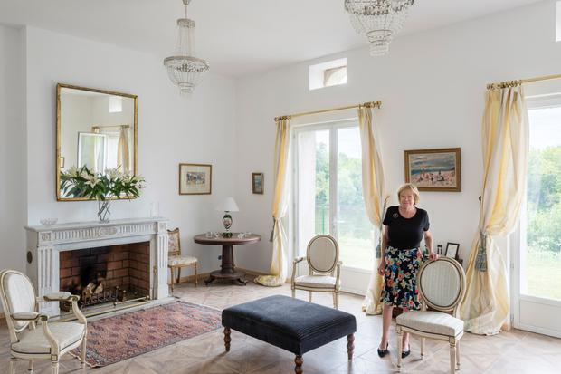 Nell in the drawing room which is furnished with family heirlooms and paintings by Irish artists including John Keating. Photo: Stanislas Ledoux