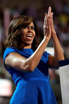 Wrapping up: First Lady Michelle Obama acknowledges the crowd after delivering her speech at the Democratic National Convention on Monday