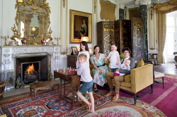 Anthony and Fionnuala in the drawing room with their four children, Aldus, Nora, Aileen, and baby Evelyn. The family use this room at Christmas and for other important occasions. Photo: Tony Gavin