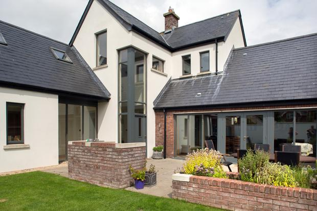 The house, which was originally a tiny cottage, is now 3,600 square feet. It's on a third of an acre, landscaped by the award-winning designer, Louth man Paul Martin