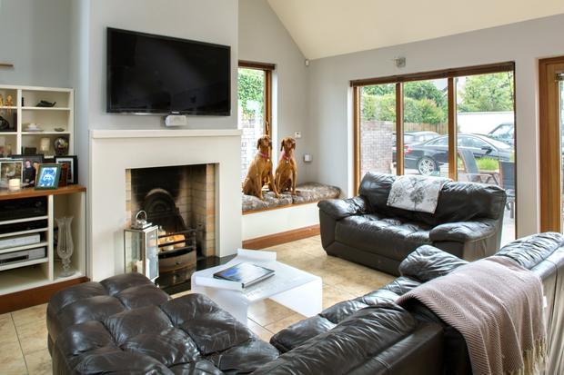 Anne's much-loved Hungarian Vizslas, Beau and Sadie, have their own specially designed window seat in the living room, but like to leap onto the leather seating when no one is looking