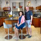 Anne Mc Entegart and her husband Eugene in their cherrywood kitchen, which was designed by local craftsman John Stewart. 'I'm very strong on working with local businesses,' says Anne. Photo: Tony Gavin