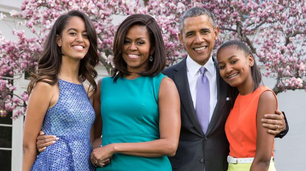 New normal: Michelle and Barack Obama with daughters Malia (18) and Sasha Obama (15), pictured far right, who has begun a summer job in a restaurant