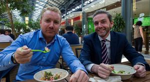 Green giants: Ian Crotty, 36, and Malachy Kearney, 40, tuck into their salad lunches from Freshii in CHQ Building in Dublin yesterday. Photo: Douglas O'Connor