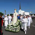 Pilgrims follow a statue of Our Lady during the Rosary Procession from the Basilica to the Shrine in Knock, Co Mayo. Photo: Frank Mc Grath
