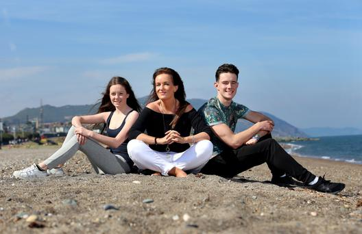 Ciara Kelly with her teenage children Ella, 14, and Oisin, 15, on Greystones beach. Photo: Frank Mc Grath