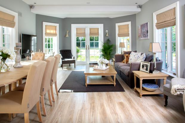 The oak-floored dining area is furnished with an American white-oak table, and linen-covered chairs. George the dog likes to lounge on the sofa