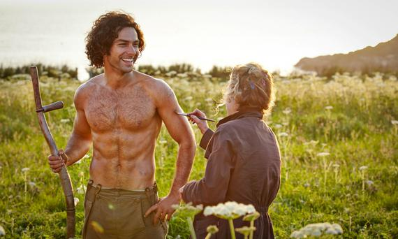 Toned and tanned: Turner on the set of 'Poldark', during that shirtless scene