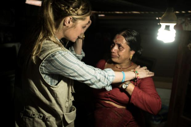Laura with single mother Sitha Adhikari in the temporary shelther the mum of two has been living in for over a year. Photo: Matthieu Chardon @Matthieufilms