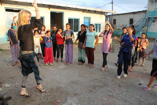 Laura gets some tips on dancing from the girls at Shakti-Samuha group in a Kathamandu slum. Photo: Matthieu Chardon @Matthieufilms
