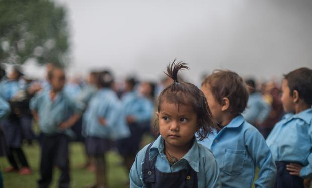One of the little girls who attends Ainselukharka High School, 'The School in the Clouds', during a morning exercise session. Photo: Matthieu Chardon @Matthieufilms
