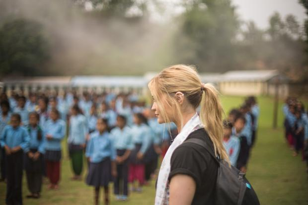 Laura watches assembly at Ainselukharka High School in Sindhupalchowk District. Photo: Matthieu Chardon @Matthieufilms