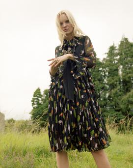 Printed chiffon dress, €3,500, Gucci; crystal brooch; €725, Lanvin; model's right hand: cocktail ring, €100, Kenneth Jay Lane; model's left hand: pearl ring, €270, Lanvin; ring, €160, Marni