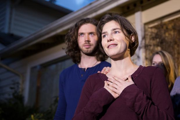 Aftermath: Amanda Knox, seen here with her fiance Colin Sutherland