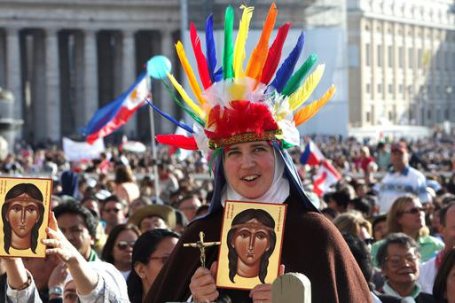 Holy show: A nun at the canonisation of the first Native American saint Caterina Tekakwitha (known as Lily of the Mohawks) held by Pope Benedict XVI in 2012