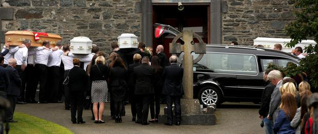Tragedy: The remains of Alan Hawe and his three sons Liam, Niall and Ryan are taken into the Church for funeral Mass in Castlerahan earlier this month. Photo: Gerry Mooney