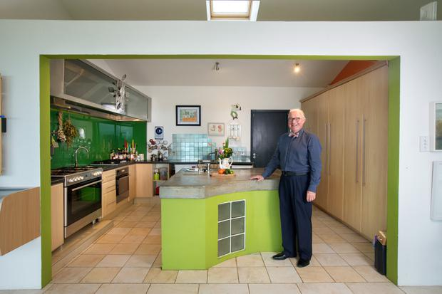 Damien in the kitchen with its lime-green island. Paula is the cook but Damien, whose brother is Francis Brennan, is famous for his tea brack. 'It's our signature, I made 12 yesterday,' he notes