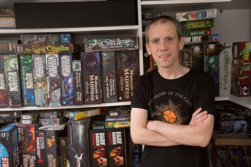 Role play: Ed Power with his treasure trove of board games Photo: Mark Condren