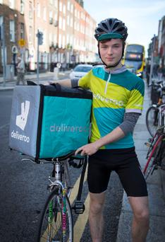 Hands on experience: Deliveroo courier and entrepreneur Tom Pywell pictured at Nassau Street. Photo: Colin O'Riordan