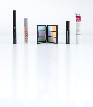 Pictured, from left, Bobbi Brown Retouching Wand; Urban Decay Naked Skin Color Correcting Fluid in Pink; Sleek Makeup Colour Corrector Palette; Giorgio Armani High Precision Retouch; Guinot Cover Touch Concealer