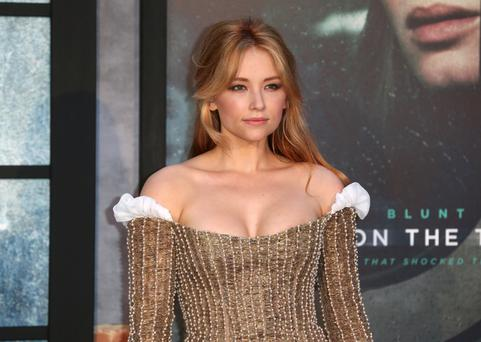 Haley Bennett looked stunning in this gold Valentino dress at the premiere of The Girl On The Train in London recently despite suffering from the 'flu