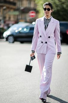 The street is a runway: Caroline Issa wears a pink suit outside the Dries Van Noten show during Paris Fashion week