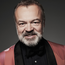 Graham Norton's debut novel, Holding, will be produced for television by the former boss of EastEnders.