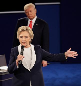 He's behind you: Trump listens to Clinton during the second presidential debate at Washington University last Sunday. Photo: John Locher