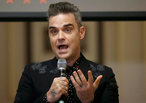 Robbie Williams is back to his best with a new album and world tour